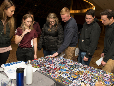Attendees looking at patches and merchandise
